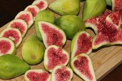 Fresh figs. On a wooden Board, cut in half Stock Image