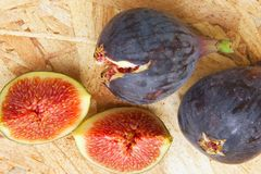 Fresh figs. On a wooden surface stock photo