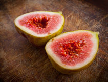 Fresh figs on the wooden table. Royalty Free Stock Photo