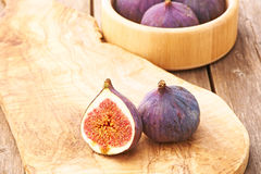 Fresh figs on wooden table Royalty Free Stock Images
