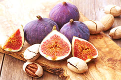 Fresh figs on wooden table Royalty Free Stock Image