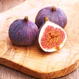 Fresh figs on wooden table Stock Photography