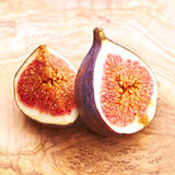 Fresh figs on wooden table Stock Photo
