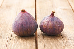 Fresh figs on wooden table Stock Image