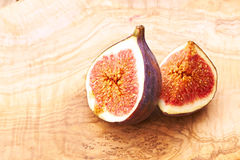 Fresh figs on wooden table Stock Images