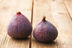 Fresh figs on wooden table Stock Photos