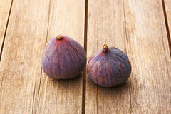 Fresh figs on wooden table Royalty Free Stock Photo