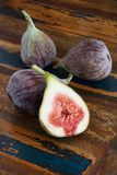 Fresh figs on a wooden table Stock Images