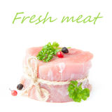 Fresh fillet of raw pork with spices and herbs on a white backgr Stock Photo