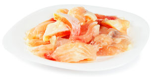 Fresh filleted fish. On porcelain plate over white background Stock Photos