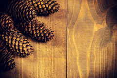 Fresh fir branches. Christmas Border - a strip of fresh fluffy fir branches with cones on a wooden background royalty free stock photo