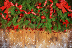 Fresh fir branches. Christmas Border - a strip of fresh fluffy fir branches with cones on a wooden background stock photography