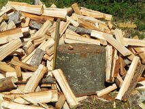 Fresh firewood splits at log Royalty Free Stock Photo
