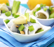 Fresh fish. Some fresh fish with paprika and lemons in a bowl Stock Photography