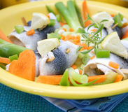 Fresh fish. Some fresh fish with paprika and lemons in a bowl Royalty Free Stock Photo