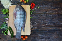 Fresh fish with aromatic herbs, spices, salt with lemon with cho Stock Image