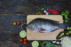 Fresh fish with aromatic herbs, spices, salt with lemon with cho Royalty Free Stock Photo