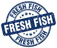 Fresh fish blue stamp. Fresh fish blue grunge round stamp isolated on white background Royalty Free Stock Photography