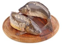 Fresh fish (carp) on wooden board Royalty Free Stock Images