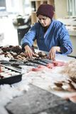 Fresh fish and clams presentated by the fishdealer Stock Image