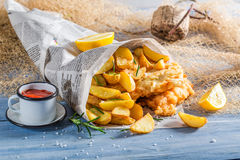 Fresh fish cod with chips with lemon Stock Images