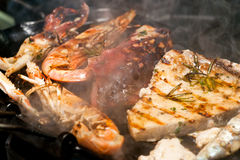 Fresh fish cooked in a grill. Royalty Free Stock Photography