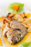 Fresh fish cooked with potatoes Stock Photo
