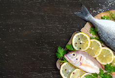 Fresh fish on dark vintage background. Fresh fish on a dark vintage background Stock Photo