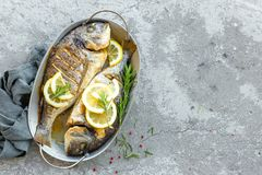 Free Fresh Fish Dorado. Raw Dorado Fish With Lemon And Rosemary. Sea Bream Or Dorada Fish Royalty Free Stock Images - 114971639