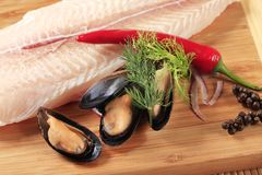 Fresh fish fillet and mussels Royalty Free Stock Image