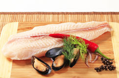 Fresh fish fillet and mussels Royalty Free Stock Photo
