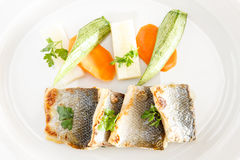 Fresh fish fillet. With Pan-fried, saffron potatoes buttered vegetables, lemon and olive oil stock photos