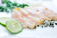 Fresh fish fillet sliced on white background royalty free stock photography