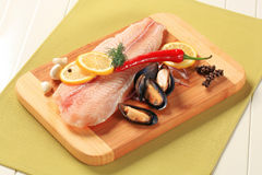 Fresh fish fillets and mussels Stock Photography