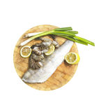 Fresh fish fillets, shrimp, lemon and onions on board, white background Royalty Free Stock Photography