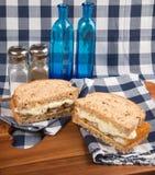 Fresh fish finger sandwich on wholegrain in rustic kitchen setti Stock Photos