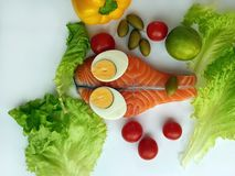 Fresh Fish Raw Salmon Two steaks with ingredients vegetables and spices tomatoes lemon and olives cucumber green salat onion g. Fresh Fish Food healthy food stock photo