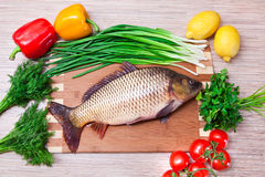Fresh fish on a kitchen board Royalty Free Stock Image