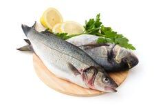 Fresh Fish. Fresh fish with lemon and parsley. Isolated on white background stock images