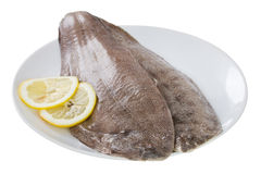 Fresh fish with lemon Stock Images