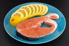 Fresh fish with lemon Royalty Free Stock Photo