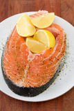 Fresh fish with lemon Stock Image