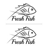 Fresh fish logo symbol icon sign simple black colored set. A set of two fish logos, black, sketch style, minimalist with a sample text Stock Images