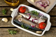 Fresh fish mackerel with spices, herbs, vegetables Royalty Free Stock Photo