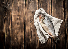 Fresh fish on the old fabric. Royalty Free Stock Photo