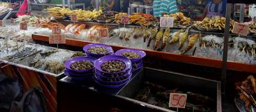 Fresh fish products displayed on a Food stall of Jalan Alor, Kuala Lumpur stock images