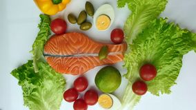 Fresh Fish Raw Salmon Two steaks with ingredients vegetables and spices tomatoes lemon and olives cucumber green salat onion g. Fresh Fish  Raw Salmon Two royalty free stock photography