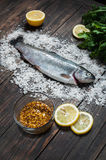 Fresh fish ready to be cook on a wooden table Stock Photography