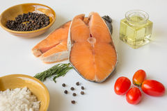 Fresh fish salmon raw salmon steak with sea salt pepper and Dill Weed isolated on a white background stock photo