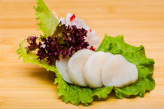Fresh fish sashimi on a wooden textured desk Royalty Free Stock Image